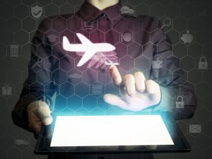 Image of a girl with tablet in her hands with aircraft icon. Buying or booking online ticket. Travel concept, business flights, airplane delivery of cargoes and goods, logistics