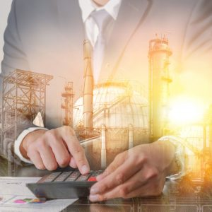 Double exposure of businessman working with calculator, oil fuel, Electric generating factory with sunset as business, Worker, Calculation, industrial and energy concept