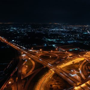 Aerial view. Traffic of expressways, motorways and highways at night.