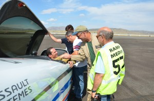 Capt. Christophe Delbos congratulated after his victory on the Big Frog diesel-powered racer.