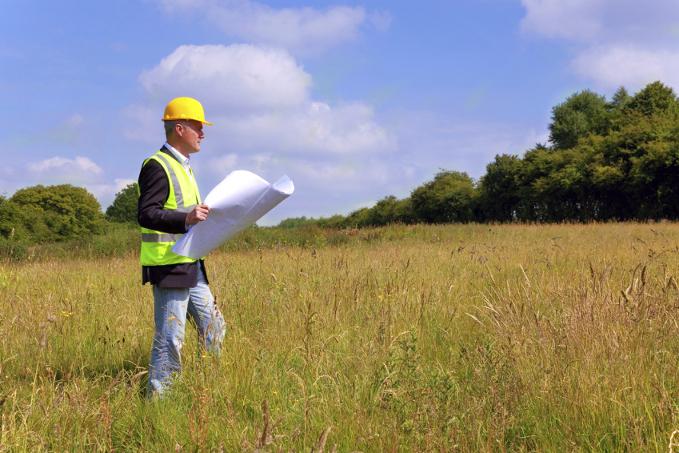 Architect in field